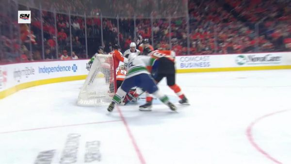 Miller scores three points, Canucks spoil Flyers opener with shootout win